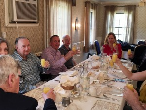 Member of the Hampton Rotary toast their last meeting.
